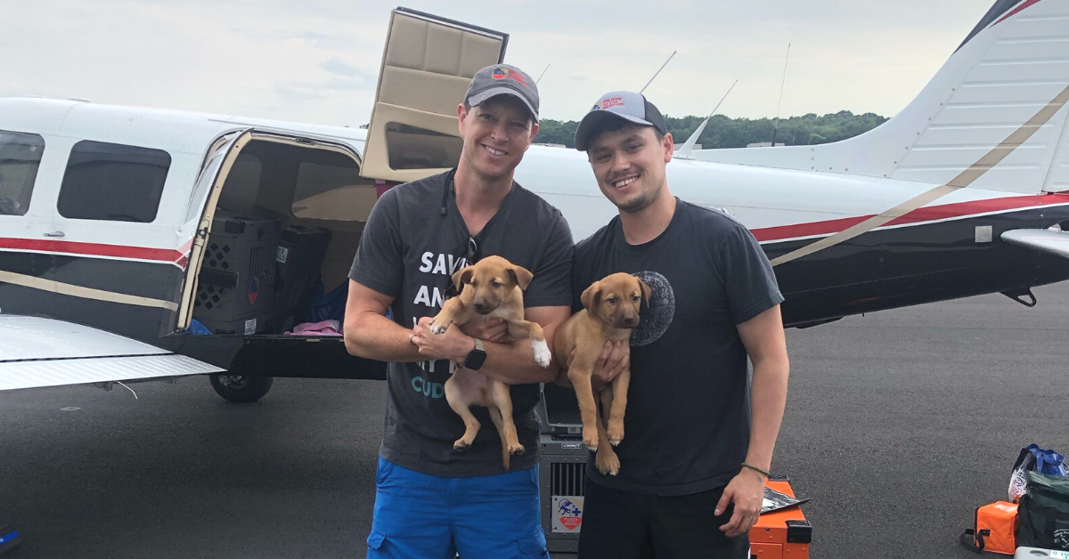 Pilots To The Rescue Top Dog Pilot Michael Schneider and Co-Pilot Daniel Baumel with Yoda and Yogi